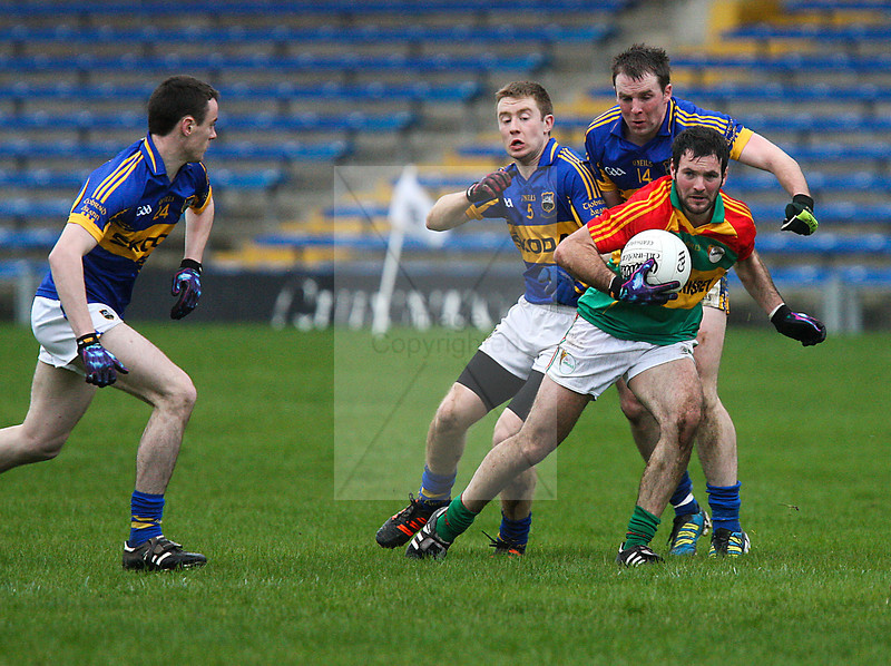 030213 Allianz Football League Division 4 Round 1.  Tipperary v Carlow.     Derek Hayden Carlow,shakes of Tipperary's Peter Acheson and Brian Fox.  Photo Andy Jay.