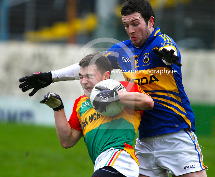 030213 Allianz Football League Division 4 Round 1.  Tipperary v Carlow.  Tipperary's  Barry Grogan closes in on Carlow's Kieran Nolan during Sunday's Division Four Round one Allianze Football game in Thurles. Photo Andy Jay.