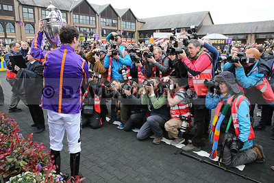 Patrick Mullins in front of the paparazzi after Wicklow Brave's win in the BETDAQ Punchestown Champion H´dle (Grade 1) at the Punchestown Festival (April 2017)