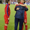 Lauren Holiday (12) - U.S. Women's Soccer Team reaches 100 caps vs. France with Christie Rampone (left) and Head Coach Jill Ellis, Raymond James Stadium, Tampa - 14 June 2014 (Photographer: Nigel Worrall)
