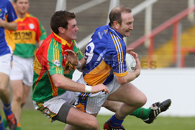 Former Wicklow player Thomas Walsh pulls down Paddy Dalton in the Leinster Senior Football Championship (May 2010)