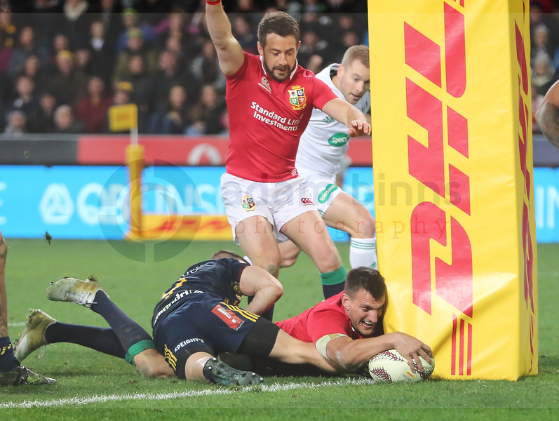Sam Warburton of the Lions, right, dives in to score a try as Greig Laidlaw, top, celebrates during the match between the Crusaders and the British and Irish Lions at Forsyth Barr Stadium, Dunedin, New Zealand, June 13 2017. (AAP IMAGE/Adam Binns) NO ARCHIVING, EDITORIAL USE ONLY