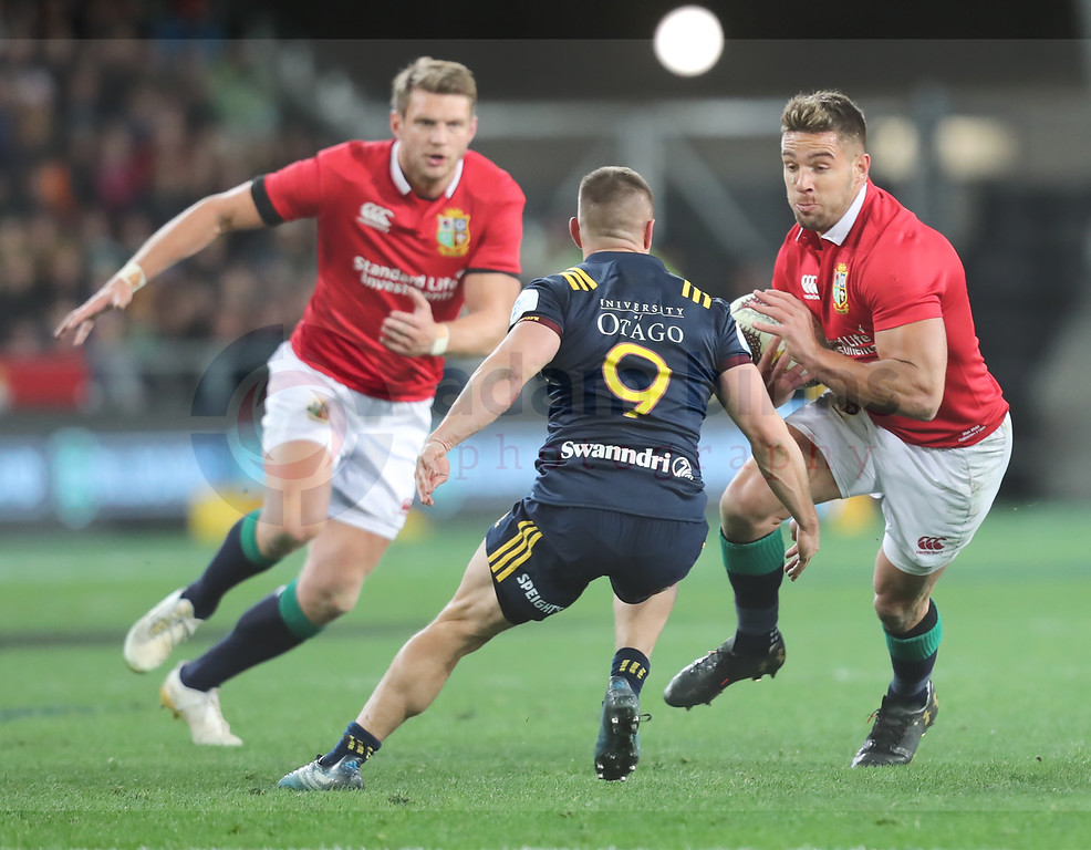 Rhys Webb of the Lions, right, takes the ball toward Kayne Hammington of the Highlanders, centre, during the match between the Crusaders and the British and Irish Lions at Forsyth Barr Stadium, Dunedin, New Zealand, June 13 2017. (AAP IMAGE/Adam Binns) NO ARCHIVING, EDITORIAL USE ONLY