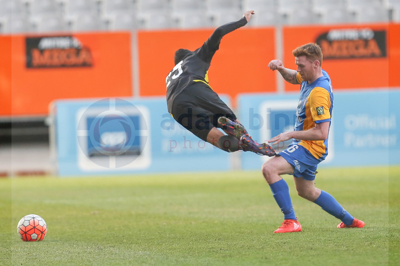 """Wellington Phoenix Under 20s' Sarpreet Singh, left, comes off second best in the challenge with Southern United's Danny Ledwith, right, in the Stirling Sports Premiership football match, Forsyth Barr Stadium, Dunedin, New Zealand, Friday, November 25, 2016. © Copyright photo: Adam Binns /  <a href=""""http://www.photosport.nz"""">http://www.photosport.nz</a>"""