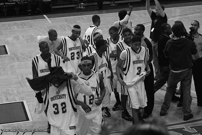After a victory huddle the team walks off the court in deep thought.