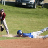 Geneseo's #5 makes contact with the base on a head first slide before #13 of Caledonia recieves the pass.<br /> Benjamin Gajewski / North Street Studios