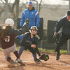 Geneseo's pitcher, #3, made it back to home plate in time to catch a pass and tag Caledonia's #6 out before she scored a run.<br /> Benjamin Gajewski / North Street Studios