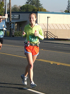 Hey--there's that stupid cheesy smile I seem to do while I'm running... No, that's not two thumbs up--it's a gu and water.