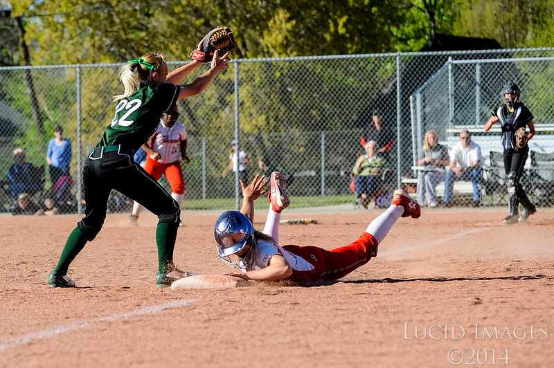 Bountiful's Brook Dickerson narrowly misses getting tagged out by Makell Steele of Payson High School at Millcreek Junior High School in Bountiful on April 17, 2014. (ROBBY LLOYD/ Special to the Standard-Examiner)