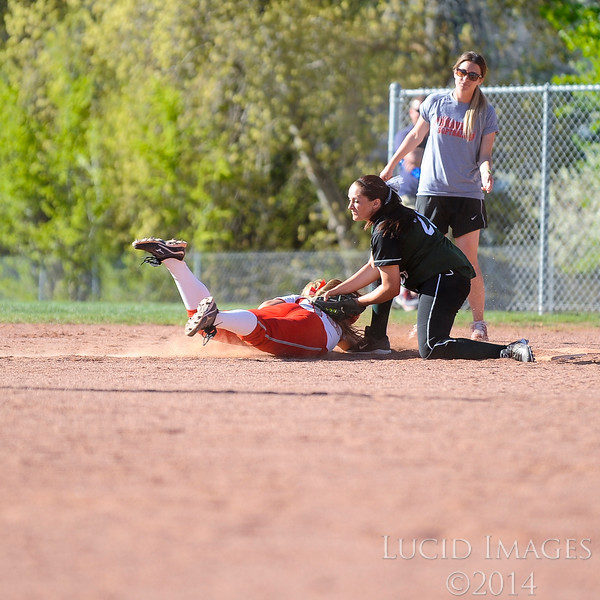 Jayden Draper of Payson High School makes one of the most crucial plays of the game by tagging out McKenna Alley of Bountiful High at first base to end the game 6-5 in Payson High's favor at Millcreek Junior High School in Bountiful on April 17, 2014. (ROBBY LLOYD/ Special to the Standard-Examiner)