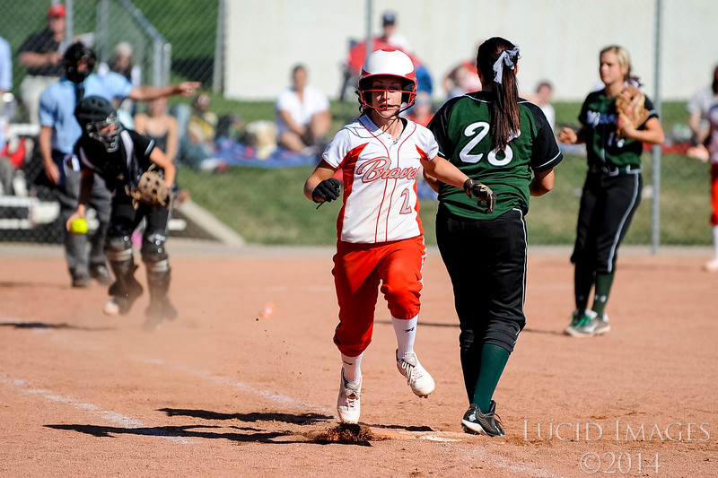 Landi Hawker of Bountiful High makes it on base after a successful bunt against Payson High School at Millcreek Junior High School in Bountiful on April 17, 2014. (ROBBY LLOYD/ Special to the Standard-Examiner)