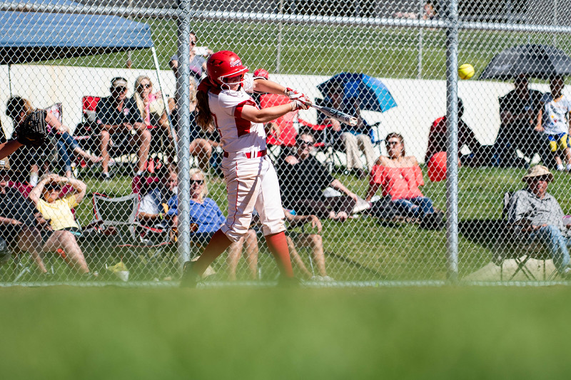 Abby Steed (27), of Bountiful, hits a base run against the pitching of Brylee Marziale (7, not pictured), at Millcreek Junior High, in Bountiful, on May 8, 2018.