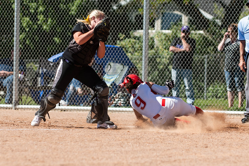 Box Elder catcher, Maycen O'neal (15), tries to make the tag after catching a high throw, but is too late, allowing Bountiful base runner, Dashani Purcell (9), to score, at Millcreek Junior High, in Bountiful, on May 8, 2018. Purcell's run was the sixth of the inning, putting Bountiful in a commanding 6-0 lead.
