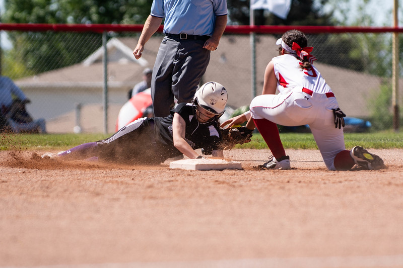 Sydnie Blacker (12), of Box Elder, is tagged out at second base by Bountiful player, Dashini Purcell (9), at Millcreek Junior High, in Bountiful, on May 8, 2018.