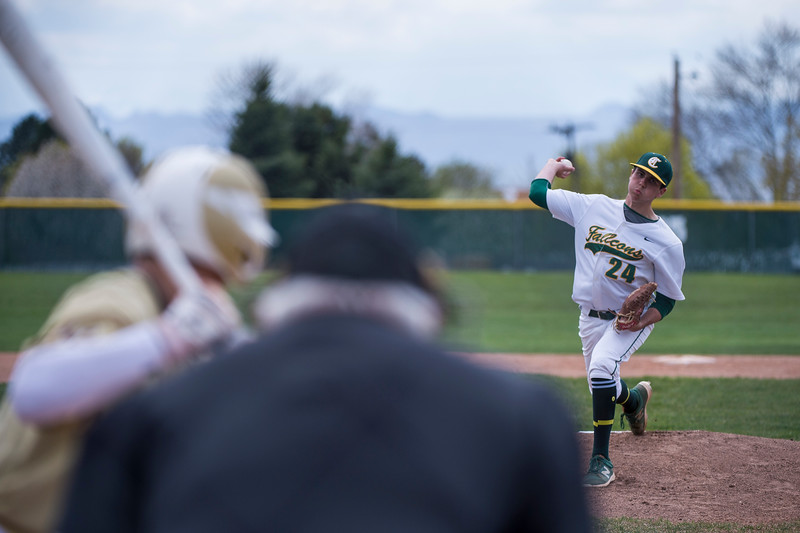 Cade Parry (24), of Clearfield High, hits Davis player, Zachary Mansfield (11), in the head on the very first pitch of the game, at Clearfield High School, in Clearfield, on Friday, April 20, 2018.