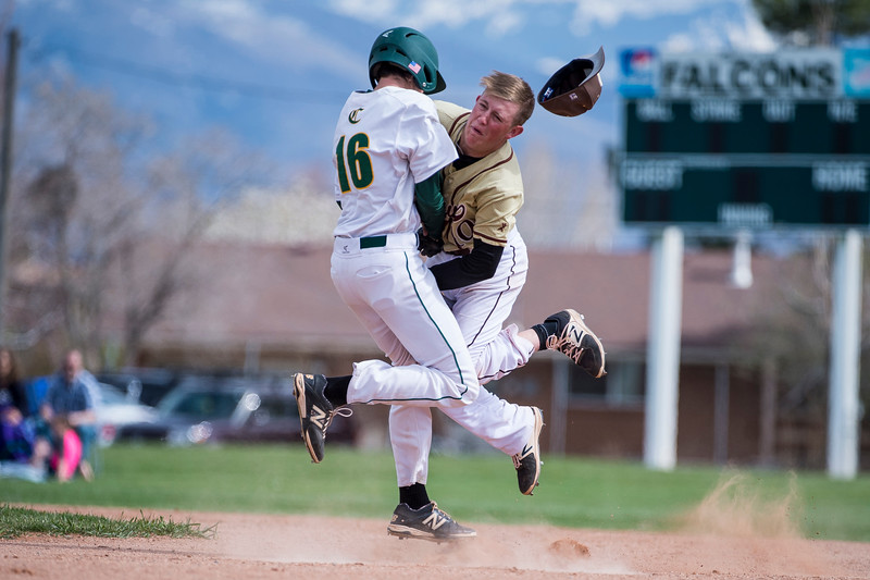 Base runner Ty Witt (16), of Clearfield, collides hard with Parker Jensen (10), of Davis High, while trying to get to second base, at Clearfield High School, in Clearfield, on Friday, April 20, 2018. Jensen took the brunt of the impact and went down for several minutes before continuing to play.