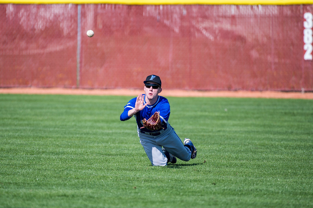 Brett Hannock (9), of Fremont High, dives for a ball, but comes up just short of getting the out against Northridge, at Northridge High School, in Layton, on Wednesday, April 19, 2017.