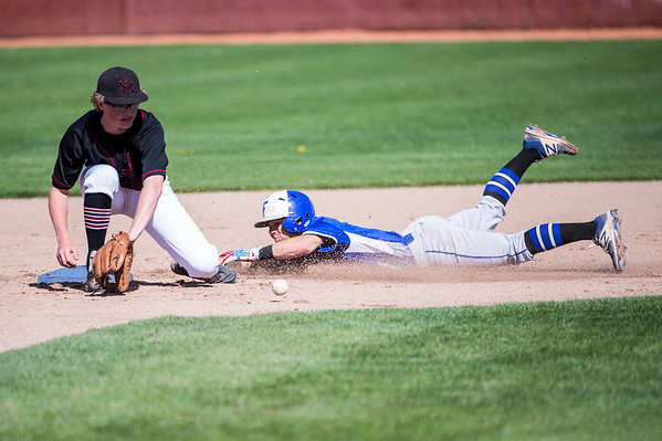 Haze Hadley (5), of Fremont High, beats the throw to steal second base against the catch of Jake Porter (19), of Northridge, at Northridge High School, in Layton, on Wednesday, April 19, 2017.