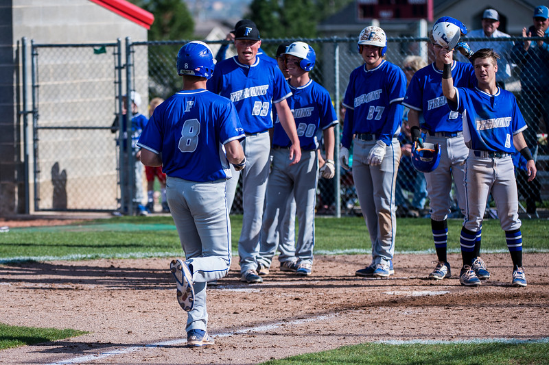Kade Skeen (8), of Fremont High, is welcomed home by his teammates after hitting a grand slam in the top of the third inning to put Fremont up 11-3 over Northridge, at Northridge High School, in Layton, on Wednesday, April 19, 2017.
