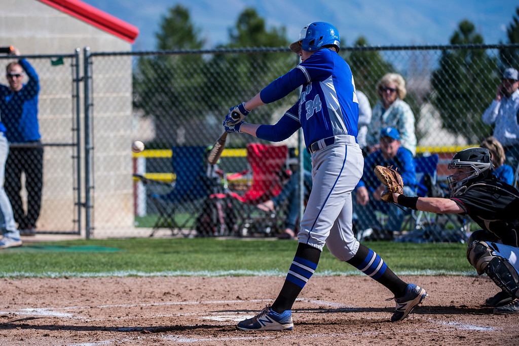 Kyler Bush (34), of Fremont High, gets ahold of a pitch for a base hit that drove in a run against Northridge, at Northridge High School, in Layton, on Wednesday, April 19, 2017.