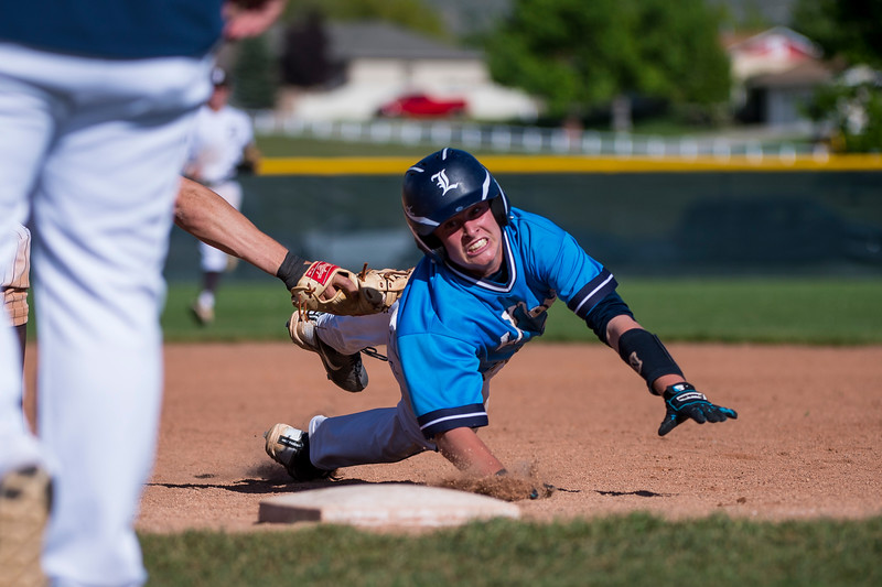 Mitchell Smith (16), of Layton High, gets tagged out to end the game, by Davis first baseman Ben Rigby (13), after getting caught in a pickle at Davis High School, in Kaysville, on May 5, 2017.