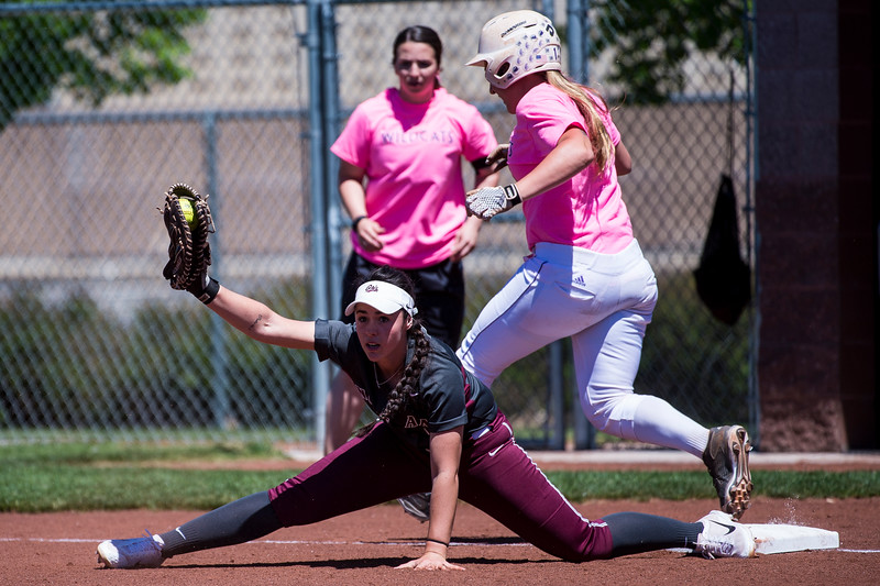 Ashlyn Lyons (13), of Montana, extends to get out the runner, Riana Splinter (1), of Weber State, at Weber State University, in Ogden, on Friday, May 5, 2017.