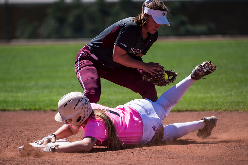 Riana Splinter (1), of Weber State, slides in safe to second base under the glove of Delene Colburn (8), of University of Montana, after hitting the ball deep into center field at Weber State University, in Ogden, on Friday, May 5, 2017.
