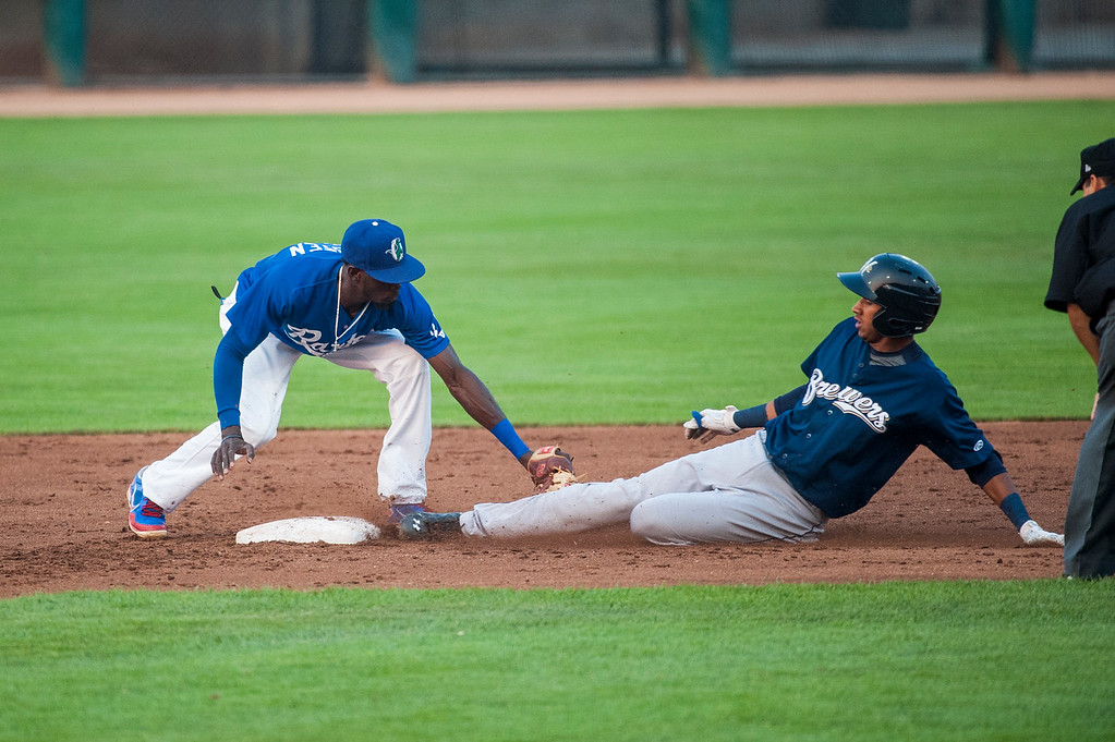 Jonathan Oquendo (3), of the Brewers, is called safe by the umpire even though the photo appears to show him tagged out by Raptors second baseman Faustian Oguisten (6) at Lindquist Field on August 20, 2015.