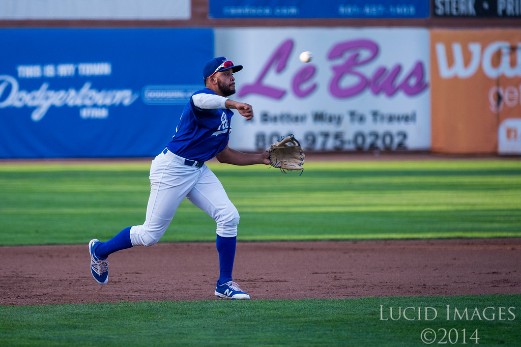 Raptors third baseman, Jared Walker (41), throws out Hunter Milton (15), of Grand Junction, at first base for the second out of the inning at Lindquist Field in Ogden on August 26, 2016.