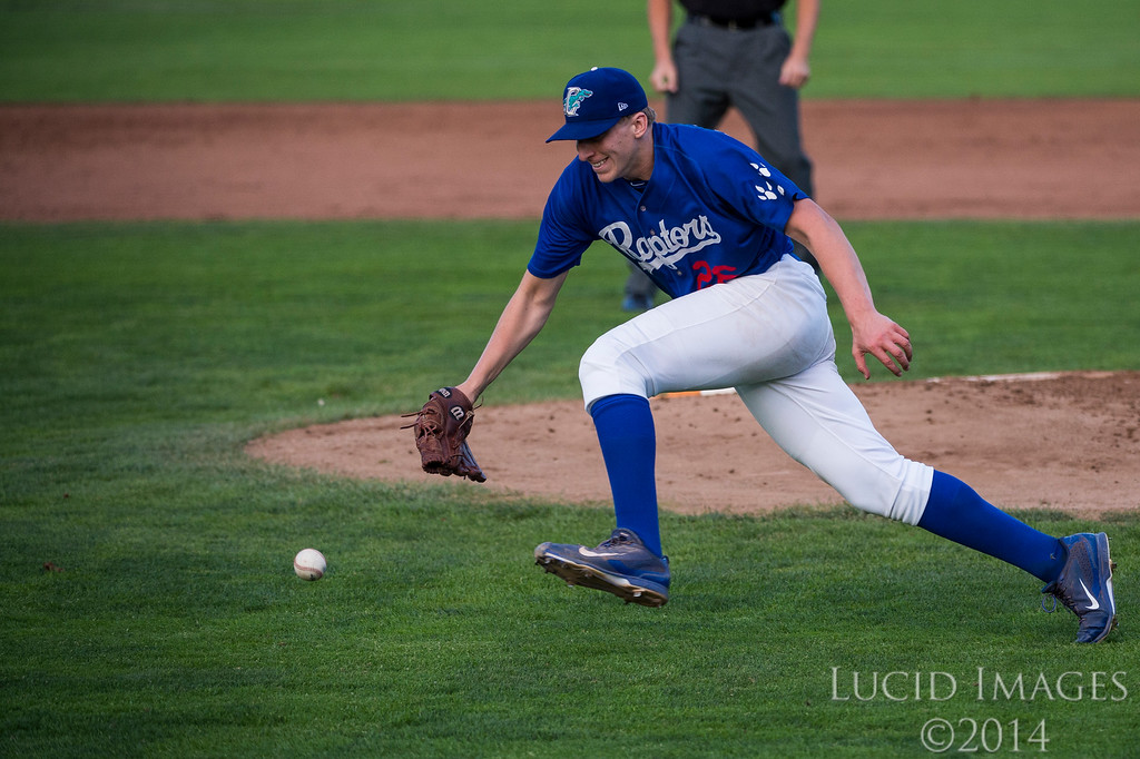 Rob McDonnell (26), pitcher for the Raptors, fails to get to a bundt by Grand Junction designated hitter, Tyler Bugner (11), in time and allows a run by Pedro Gonzalez (22) at Lindquist Field in Ogden on August 26, 2016.