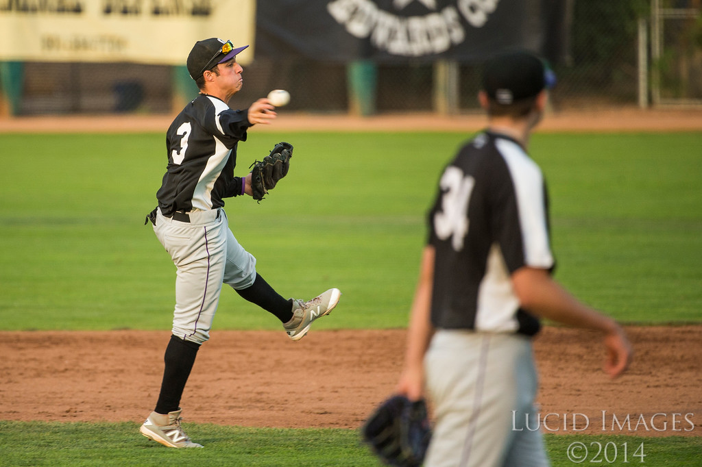 Jose Gomez (3), of Grand Junction, hustles to make a throw to first base to try to get out DJ Peters (27), of the Raptors, but comes up short at Lindquist Field in Ogden on August 26, 2016.