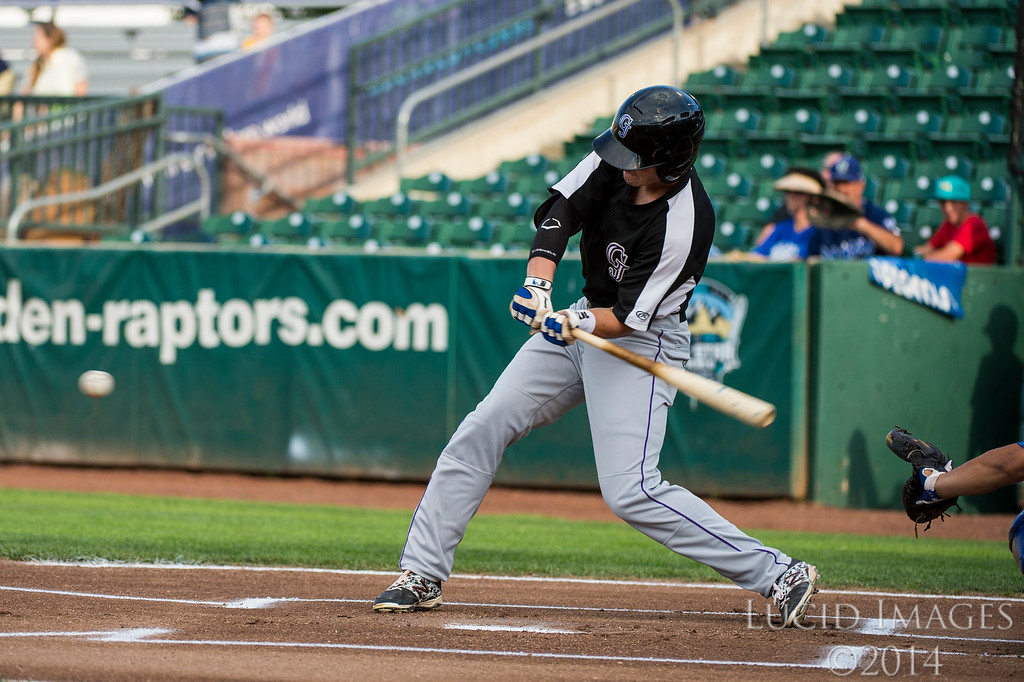 Grand Junction designated hitter, Tyler Bugner (11), swings for a double to open up the game against the pitching of Raptors player, Rob McDonnell (26), at Lindquist Field in Ogden on August 26, 2016.