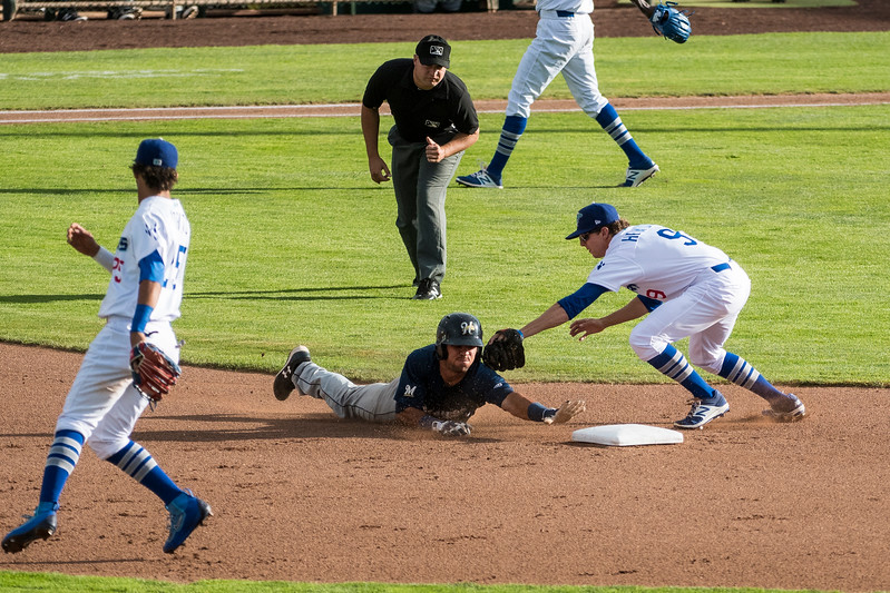 Connor Heady (9), of Ogden, tags out Helena runner Dallas Carroll (29), at Lindquist Field, in Ogden, on Monday July 17, 2017.