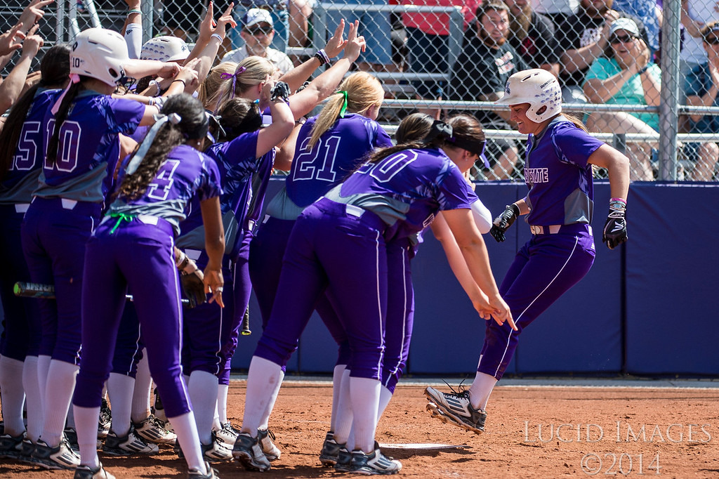 Aubrey Whitmer (5), of Weber State, triumphantly hops on home plate after hitting a two run home run against Idaho State, to put Weber up 5-0 in the third inning at the Big Sky Softball Championship playoffs at Weber State University on May 13, 2016.