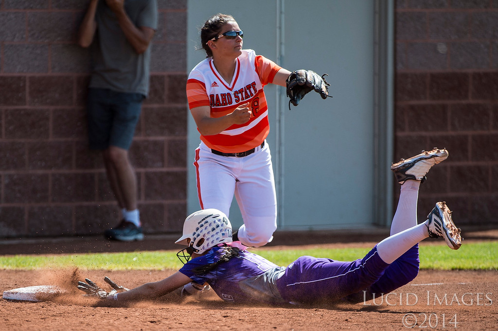 Mackenzi Corta (10), of Weber State, hustles to turn a double into a triple and makes it safely ahead of the throw to third base Idaho State player, Aubrey Creekmore (8), at the Big Sky Softball Championship playoffs at Weber State University on May 13, 2016.