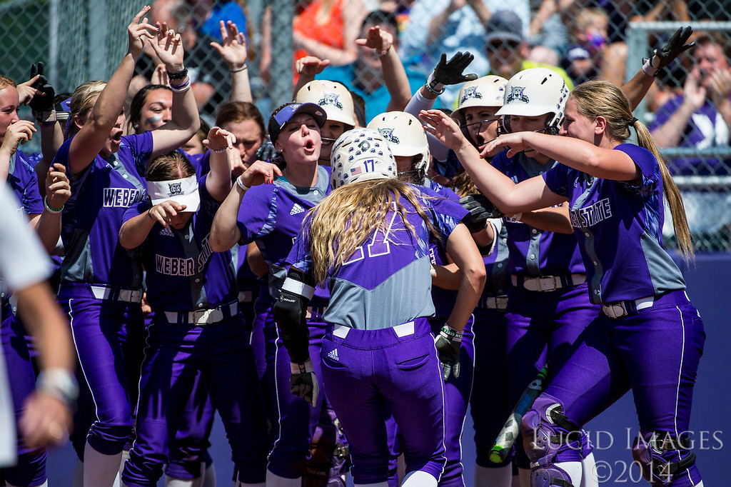 The Weber State dugout empties to congratulate Sara Hingsberger (17) who hit a three run homer against Idaho State to open up the game in the first inning at the Big Sky Softball Championship playoffs at Weber State University on May 13, 2016.