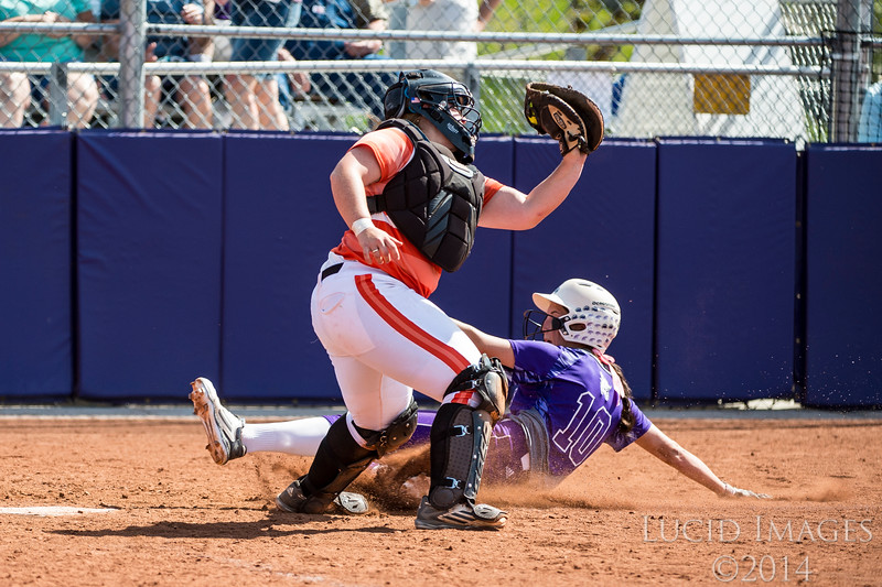 Mackenzi Corta (10), of Weber State, slides in safe to home plate past the defense of Idaho State catcher to put the Wildcats ahead 6-0 in the fifth inning at the Big Sky Softball Championship playoffs at Weber State University on May 13, 2016.