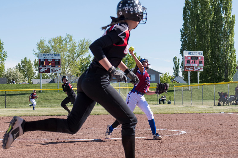 Fremont pitcher, Lacey Kearsley (20), throws to stop Weber High runner, Lexy Shaw (24), from scoring a run, at Fremont High School, in Plain City, on Tuesday, May 1, 2018.