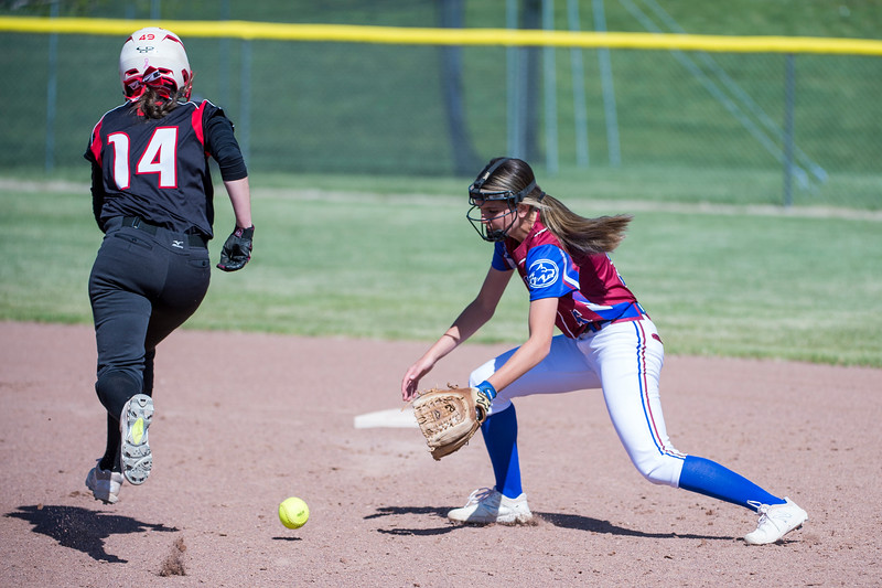 Stalee Hadley (4), of Fremont High, momentarily struggled to field a grounder, but recovered in time to make the play at first, while the Weber base runner, Miranda Dee (14), easily gets by safely to second, at Fremont High School, in Plain City, on Tuesday, May 1, 2018.
