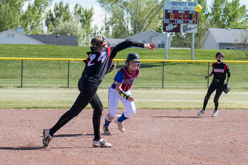 Lexy Shaw (24), of Weber High, throws over the top of Fremont base runner, Rylie Bennett (7), to make the out at first and end the inning at Fremont High School, in Plain City, on Tuesday, May 1, 2018.