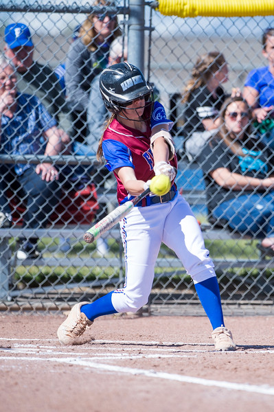 Kynlee Hoggan (14), of Fremont High, connects with the ball for a double hit deep to the fence line against the pitching of Weber player, Brooke Merrill (10, not pictured), at Fremont High School, in Plain City, on Tuesday, May 1, 2018.