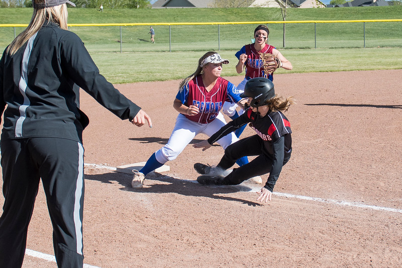 Hadley Bennett (24), of Fremont High, tags out runner Megan Havasi (9), of Weber High, at third base, after getting caught trying to take home plate, at Fremont High School, in Plain City, on Tuesday, May 1, 2018.