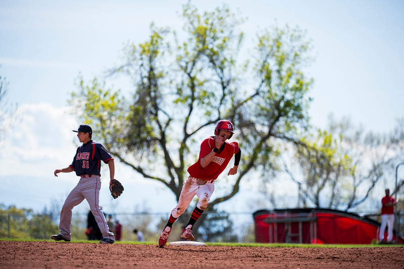 Woods Cross defeated Bountiful High 7-2, despite getting off to a slow start, at Bountiful High School, in Bountiful, on Friday, April 21, 2017.