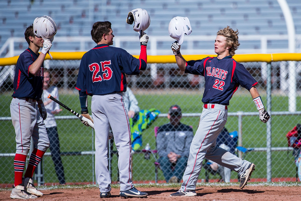 Calum Seifert (22), of Woods Cross, is congratulated at home plate after hitting a lead off home run by his teammate Hunter Stone (25), at Bountiful High School, in Bountiful, on Friday, April 21, 2017.