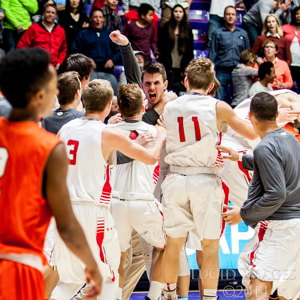 Zac Seljaas (1), of Bountiful, celebrates with his team after hitting a last second three pointer to put Bountiful up 58-56 to win the game against Murray High in the first round of the 4A Boys State Championships at the Dee Events Center in Ogden on February 24, 2015.