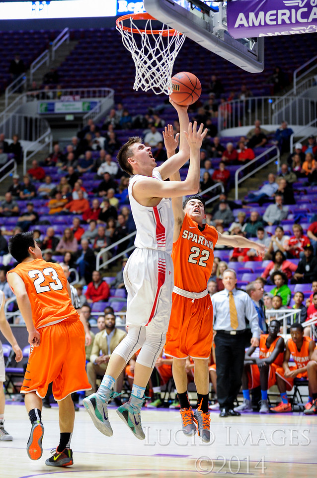 Zac Seljaas (1), of Bountiful High, puts in an easy lay up behind the defense of Murray player Peyton Christman (22) in the first round of the 4A Boys State Championships at the Dee Events Center in Ogden on February 24, 2015.