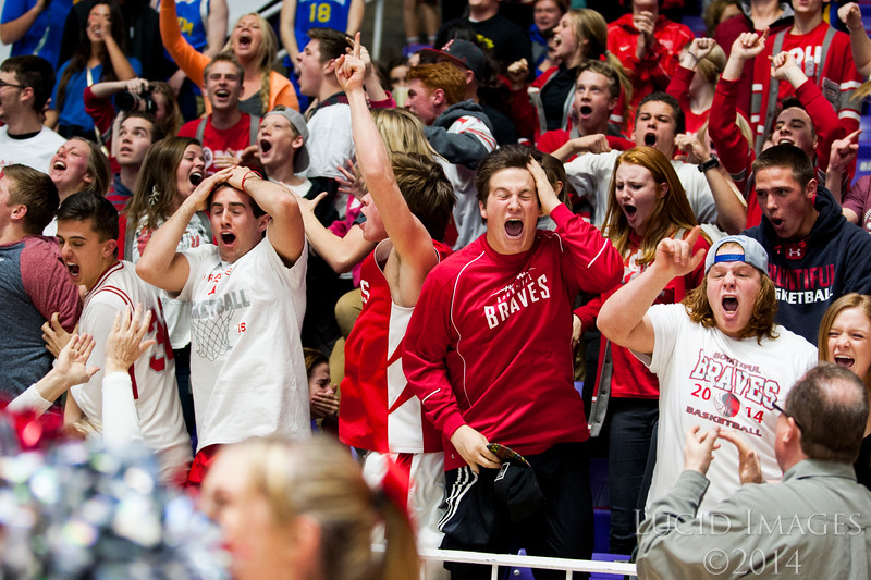 Bountiful Braves fans went crazy when Zac Seljaas hit a three point buzzer beater to win the game 58-56 against the Murray Spartans in the first round of the 4A Boys State Championships at the Dee Events Center in Ogden on February 24, 2015.