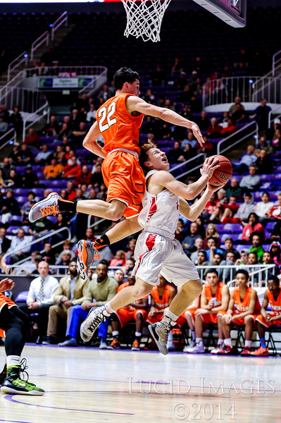 Bountiful guard Jonny Schmidt (11) gets fouled hard by Murray defender Peyton Christman (22) on the shot, in the first round of the 4A Boys State Championships at the Dee Events Center in Ogden on February 24, 2015.