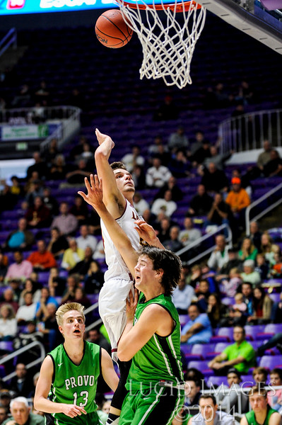 Tyler Brimhall (24), of Logan High, drives from the perimeter to make an aggressive play on the hoop against Hunter Bailey (25), of Provo High, in the opening round of the 4A Boys State Championships at the Dee Events Center in Ogden on February 24, 2015.