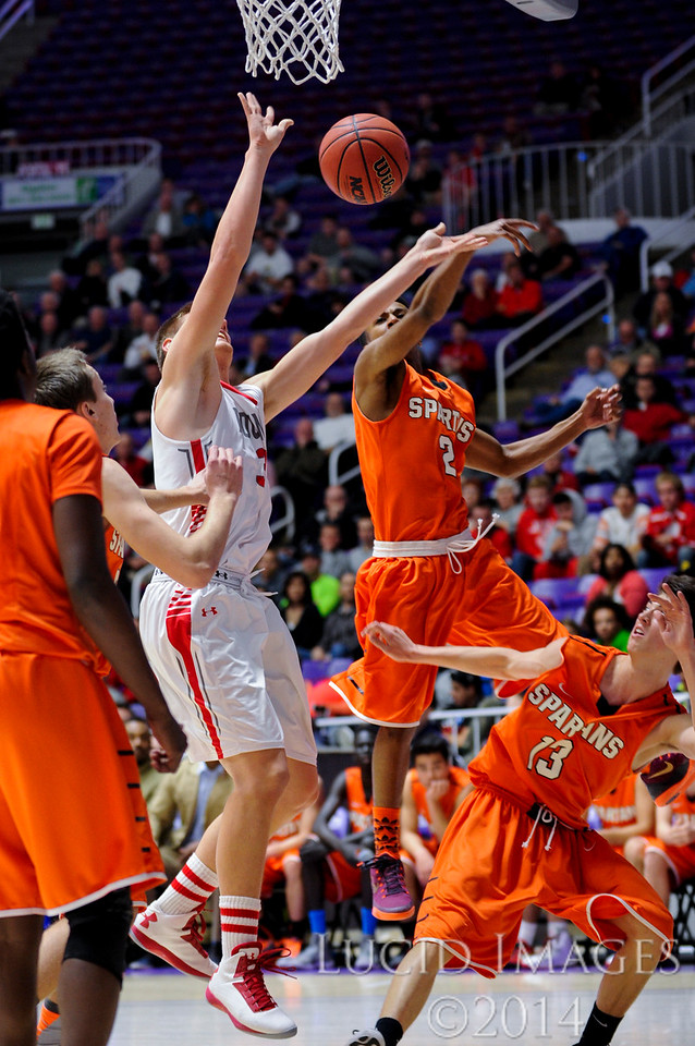 Bountiful forward Collin Parrish (33) has his shot blocked from behind by Murray defender Josh Lawrence (2) in the first round of the 4A Boys State Championships at the Dee Events Center in Ogden on February 24, 2015.